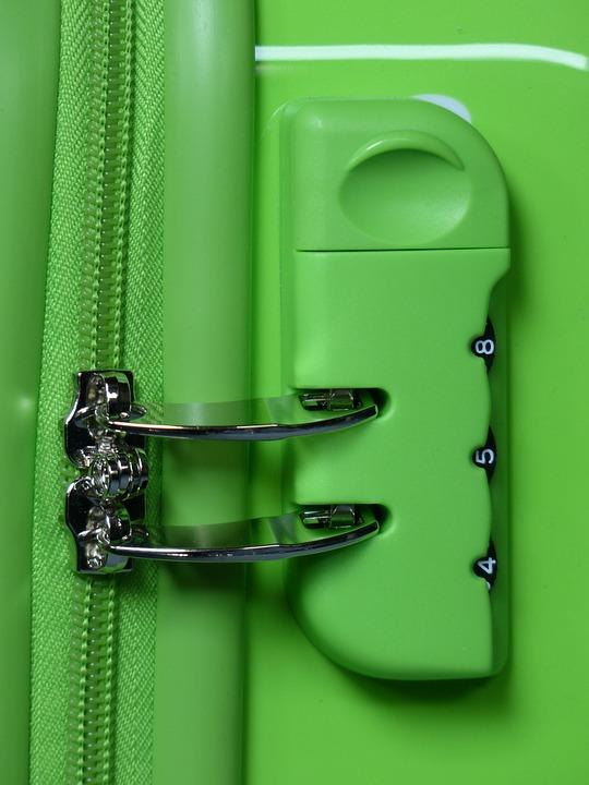 fermeture de valise verte avec deux curseurs